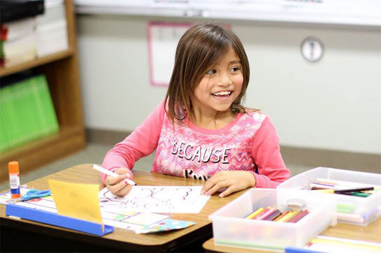 smiling girl in a classroom